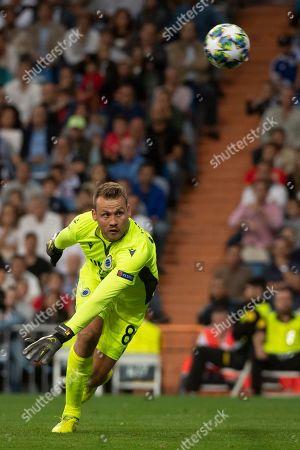 Brugge's Belgian goalkeeper Simon Mignolet receives the score if the Real Madrid's Brazilian midfielder Casemiro