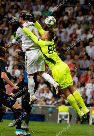 Real Madrid's Spanish defender Sergio Ramos and Brugge's Belgian goalkeeper Simon Mignolet