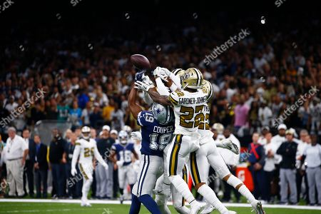 Stock Photo of New Orleans Saints defensive back Chauncey Gardner-Johnson (22) and other defenders break up a hail mary pass intended for Dallas Cowboys wide receiver Amari Cooper (19) in the final play of the second half of an NFL football game in New Orleans, . The Saints won 12-10