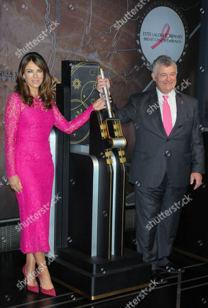 Elizabeth Hurley (L) and William P. Lauder attend a lighting ceremony in honor of Estee Lauder Company's 2019 Breast Cancer Campaign