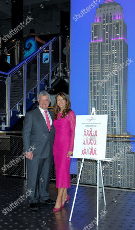 Stock Picture of Elizabeth Hurley (R) and William P. Lauder attend a lighting ceremony in honour of Estee Lauder Company's 2019 Breast Cancer Campaign