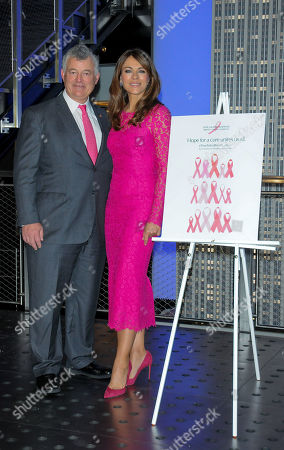 Elizabeth Hurley (R) and William P. Lauder attend a lighting ceremony in honour of Estee Lauder Company's 2019 Breast Cancer Campaign