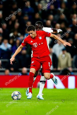Benjamin Pavard of Bayern Munich is challenged by Moussa Sissoko of Tottenham Hotspur