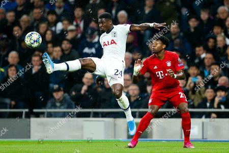 Serge Aurier of Tottenham Hotspur challenges David Alaba of Bayern Munich