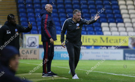 Peterborough United Manager Darren Ferguson alongside Arsenal Under 21s Manager Steve Bould