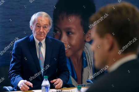 U.S. Sen. Edward Markey, D-Mass., left, and U.S. Rep. Joseph Kennedy III, D-Mass., right, participate in a roundtable discussion, in Boston, on the impact of a cap on refugee admissions to the U.S. for fiscal 2020. Massachusetts refugee resettlement agencies are urging the Trump administration to raise the admissions cap it has proposed decreasing to historically low levels