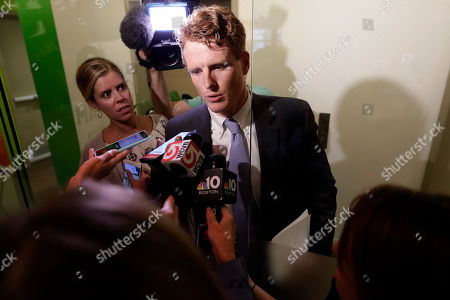 Stock Image of U.S. Rep. Joseph Kennedy III, D-Mass., speaks with reporters after participating in a roundtable discussion, in Boston, on the impact of a cap on refugee admissions to the U.S. for fiscal 2020. Massachusetts refugee resettlement agencies are urging the Trump administration to raise the admissions cap it has proposed decreasing to historically low levels
