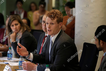 U.S. Rep. Joseph Kennedy III, D-Mass., center, participates in a roundtable discussion, in Boston, on the impact of a cap on refugee admissions to the U.S. for fiscal 2020. Massachusetts refugee resettlement agencies are urging the Trump administration to raise the admissions cap it has proposed decreasing to historically low levels