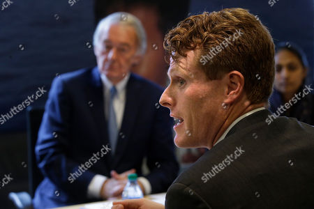 U.S. Sen. Edward Markey, D-Mass., left, and U.S. Rep. Joseph Kennedy III, D-Mass., right front, participate in a roundtable discussion, in Boston, on the impact of a cap on refugee admissions to the U.S. for fiscal 2020. Massachusetts refugee resettlement agencies are urging the Trump administration to raise the admissions cap it has proposed decreasing to historically low levels