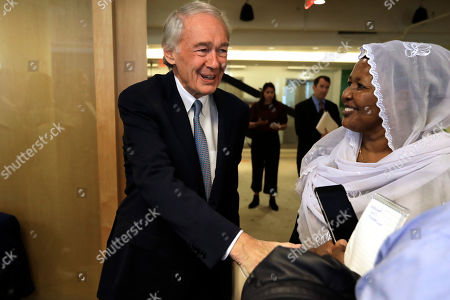 Stock Photo of U.S. Sen. Edward Markey, D-Mass., center, greets people as he arrives at a roundtable discussion, in Boston, on the impact of a cap on refugee admissions to the U.S. for fiscal 2020. Massachusetts refugee resettlement agencies are urging the Trump administration to raise the admissions cap it has proposed decreasing to historically low levels