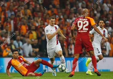 Stock Image of PSG's Thomas Meunier, centre controls the ball, during a Champions League Group A soccer match between Galatasaray and PSG in Istanbul, . PSG won the match 1-0