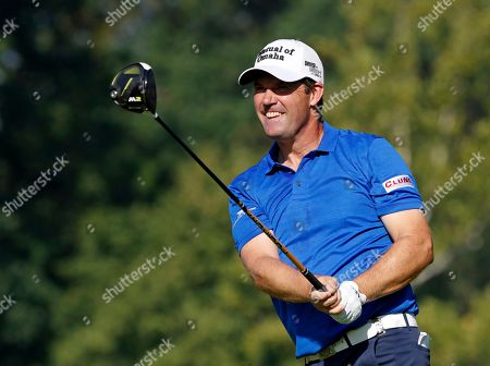 Padraig Harrington, of Ireland, watches his shot on the fifth tee during the first round of the PGA Championship golf tournament at Bellerive Country Club, in St. Louis. Steve Stricker and Padraig Harrington were at Whistling Straits in Sheboygan, Wis., on Tuesday, Oct. 1, 2019 to talk about the Ryder Cup one year before the matches are played