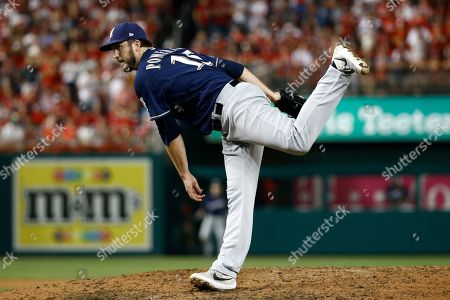 Milwaukee Brewers relief pitcher Drew Pomeranz follows through on a pitch to the Washington Nationals in the seventh inning of a National League wild card baseball game, in Washington