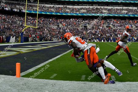 Cleveland Browns wide receiver Jarvis Landry (80) tries to score as Baltimore Ravens defensive back DeShon Elliott makes the tackle during the second half of an NFL football game, in Baltimore