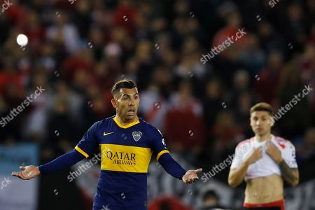 Stock Picture of Carlos Tevez of Argentina's Boca Juniors gestures during a Copa Libertadores semifinal first leg soccer match against of Argentina's River Plate at the Monumental Antonio Vespucio Liberti stadium in Buenos Aires, Argentina, . Boca lost 0-2