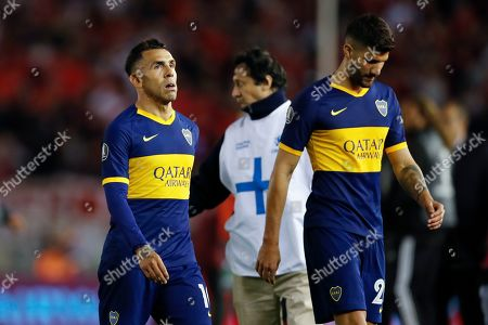 Carlos Tevez of Argentina's Boca Juniors, left, and teammates Lisandro Lopez leave the field after their 0-2 lost against of Argentina's River Plate in a Copa Libertadores semifinal first leg soccer match at the Monumental Antonio Vespucio Liberti stadium in Buenos Aires, Argentina