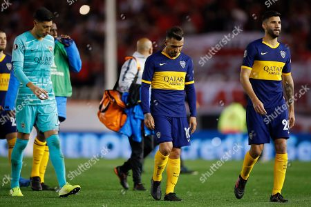 Stock Image of Carlos Tevez of Argentina's Boca Juniors and teammate Lisandro Lopez, right, leave the field after their 0-2 lost against of Argentina's River Plate in a Copa Libertadores semifinal first leg soccer match at the Monumental Antonio Vespucio Liberti stadium in Buenos Aires, Argentina