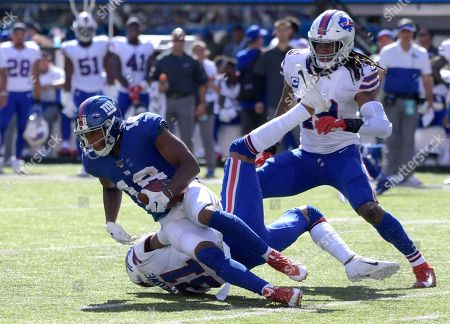 New York Giants' Bennie Fowler (18) is tackled by Buffalo Bills strong safety Dean Marlowe (31) during the second half of an NFL football game, in East Rutherford, N.J