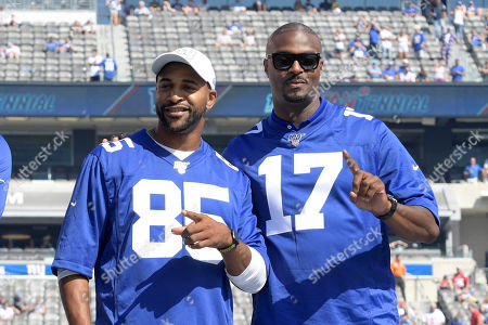 Former New York Giants wide receivers David Tyree (85) and Plaxico Burress are honored at half time of an NFL football game between the New York Giants and the Buffalo Bills, in East Rutherford, N.J