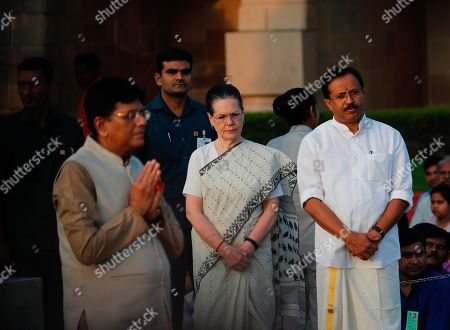 Sonia Gandhi, Piyush Goyal, V. Muraleedharan. Opposition Congress party leader Sonia Gandhi, flanked by Railways Minister Piyush Goyal, left and junior minister for external affairs V. Muraleedharan, attends an event to pay tribute to iconic independence leader Mahatma Gandhi on the 150th anniversary of his birth in New Delhi, India
