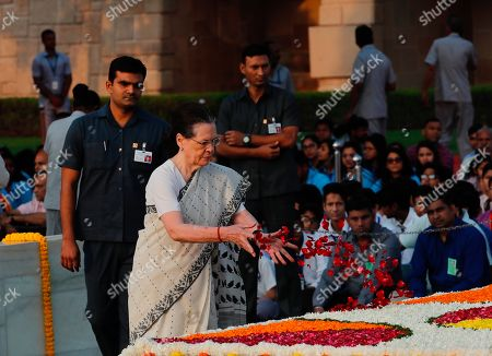 Opposition Congress party leader Sonia Gandhi, pays tribute to iconic independence leader Mahatma Gandhi on the 150th anniversary of his birth at Rajghat, the Gandhi memorial in New Delhi, India