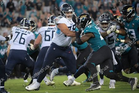 Tennessee Titans offensive tackle Jack Conklin (78) blocks against Jacksonville Jaguars defensive end Josh Allen (41) during the first half of an NFL football game, in Jacksonville, Fla