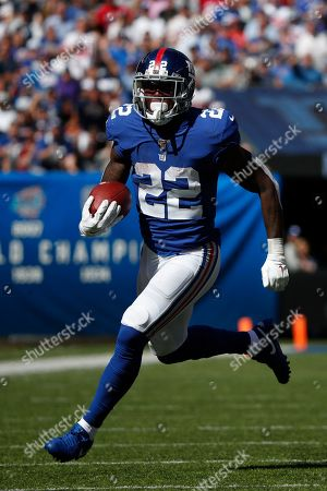 New York Giants running back Wayne Gallman (22) runs the ball against the Washington Redskins during an NFL football game, in East Rutherford, N.J. The Giants won the game 24-3