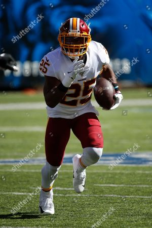 Washington Redskins running back Chris Thompson (25) runs the ball against the New York Giants during an NFL football game, in East Rutherford, N.J. The Giants won the game 24-3