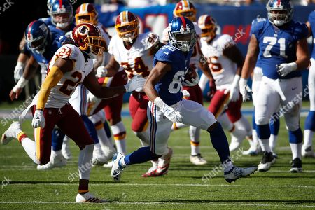 Darius Slayton, Josh Norman. New York Giants wide receiver Darius Slayton (86) is chased down by Washington Redskins cornerback Josh Norman (24) after a catch during an NFL football game, in East Rutherford, N.J. The Giants won the game 24-3