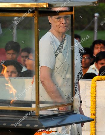 Stock Photo of Opposition Congress party leader Sonia Gandhi, pays tribute to iconic independence leader Mahatma Gandhi on the 150th anniversary of his birth at Rajghat, the Gandhi memorial in New Delhi, India
