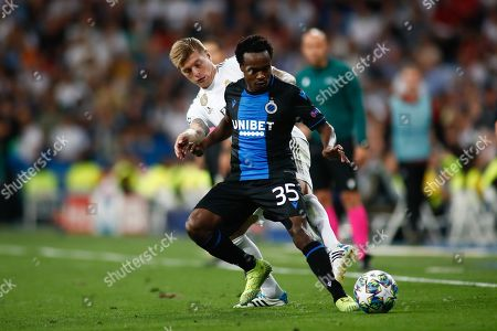 Stock Image of Percy Tau of Brujas and Toni Kroos of Real Madrid