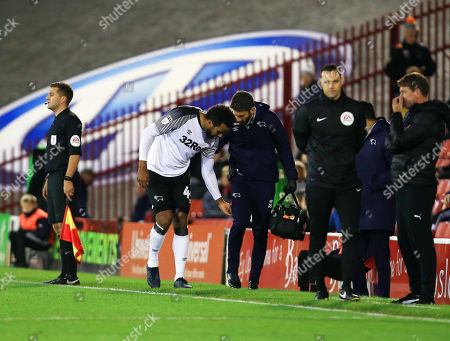 Tom Huddlestone of Derby County leaves the game through injury