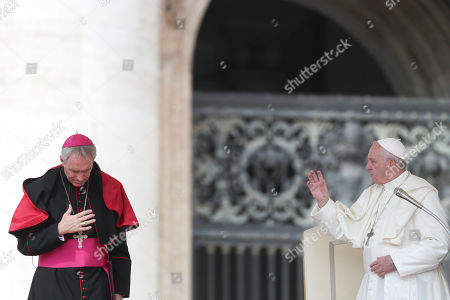 Pope Francis, flanked by Archbishop Georg Gaenswein, delivers his blessing at the end of his weekly general audience in St. Peter's Square at the Vatican