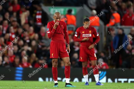 Reaction from Fabinho and Virgil van Dijk of Liverpool as the team concedes the third goal