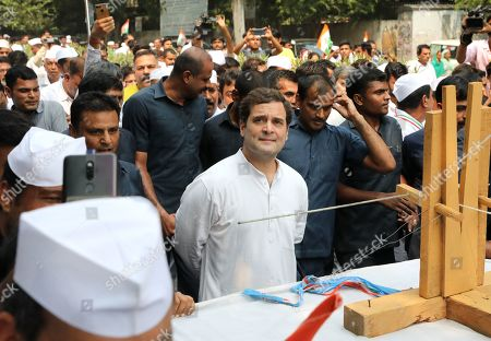 Indian National Congress (INC) Party member Rahul Gandhi(C) along with Congress Party supporters take part in a march to pay tribute to the Father of the Nation Mahatma Gandhi, in New Delhi, India, 02 October 2019. India commemorates Gandhi's 150th birth anniversary on 02 October 2019. Commemorative events are expected to take place worldwide.