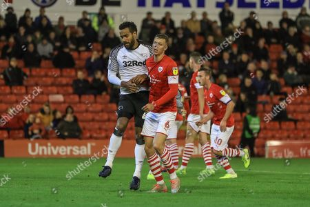 2nd October 2019, Oakwell, Barnsley, England; Sky Bet Championship, Barnsley v Derby County : Mads Andersen (6) of Barnsley bangs into Tom Huddlestone (44) of Derby County after he scores his penalty and Huddlestone hurts his knee and has to be substituted  Credit: Mark Cosgrove/News Images