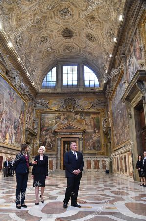 Stock Picture of US Secretary of State Mike Pompeo (R) and US Ambassador to the Holy See, Callista Gingrich (2ndL) make a private visit with a curator (L) to Sala Regia state hall following the launch of a Vatican - US Symposium on Faith-Based Organizations (FBOs), in the Vatican, 02 October 2019, as part of Pompeo's four-nation tour of Europe.