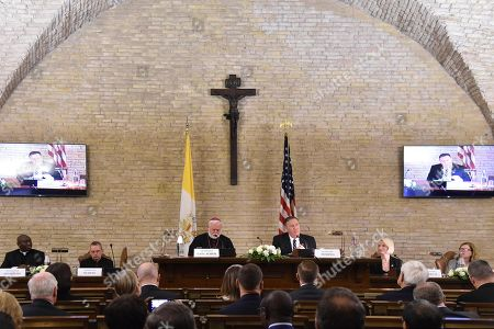 US Secretary of State Mike Pompeo (Rear C-R) gives remarks as Head of Protocol at the Holy See's Secretariat of State, Monsignor Joseph Murphy (2ndl Rear), Holy See Secretary for Relations with States, Archbishop Paul Gallagher (3rdL Rear) and US Ambassador to the Holy See, Callista Gingrich (2ndr Rear) listen during the launch of a Vatican - US Symposium on Faith-Based Organizations (FBOs), at the Old Synod Hall in the Vatican, 02 October 2019, as part of Pompeo's four-nation tour of Europe. The symposium 'Pathways to Achieving Human Dignity : Partnering with Faith-Based Organizations' is co-hosted by the Holy See's Secretariat of State and the US Embassy to the Holy See.