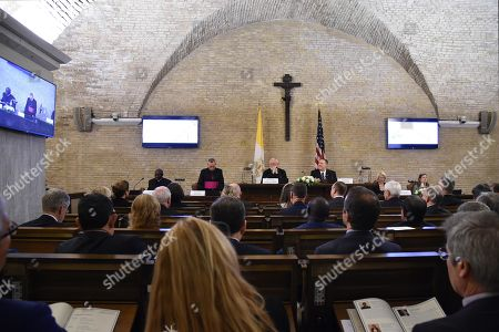 US Secretary of State Mike Pompeo (Rear C-R), US Ambassador to the Holy See, Callista Gingrich (2ndR Rear) and Holy See Secretary for Relations with States, Archbishop Paul Gallagher (Rear C) attend the launch of a Vatican - US Symposium on Faith-Based Organizations (FBOs), at the Old Synod Hall in the Vatican, 02 October 2019, as part of Pompeo's four-nation tour of Europe. The symposium 'Pathways to Achieving Human Dignity : Partnering with Faith-Based Organizations' is co-hosted by the Holy See's Secretariat of State and the US Embassy to the Holy See.