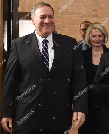 US Secretary of State Mike Pompeo (L) and US Ambassador to the Holy See, Callista Gingrich (R) arrive to attend the launch of a Vatican - US Symposium on Faith-Based Organizations (FBOs), at the Old Synod Hall in the Vatican, 02 October 2019, as part of Pompeo's four-nation tour of Europe. The symposium 'Pathways to Achieving Human Dignity : Partnering with Faith-Based Organizations' is co-hosted by the Holy See's Secretariat of State and the US Embassy to the Holy See.