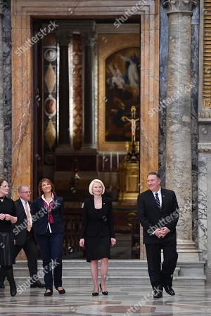 US Secretary of State Mike Pompeo (R), his wife Susan (L) and US Ambassador to the Holy See, Callista Gingrich (C) listen to a curator (2ndL Front) as they visit the Sala Regia state hall after visiting the Paolina chapel (Rear), following the launch of a Vatican - US Symposium on Faith-Based Organizations (FBOs), in the Vatican, 02 October 2019, as part of Pompeo's four-nation tour of Europe.