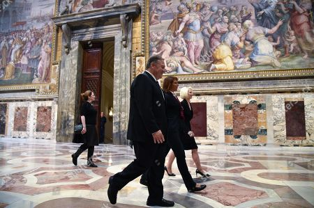 US Secretary of State Mike Pompeo (C), his wife Susan (Rear L) and US Ambassador to the Holy See, Callista Gingrich (Rear R) walk across the Sala Regia state hall with a curator (Rear C) during a private visit following the launch of a Vatican - US Symposium on Faith-Based Organizations (FBOs) in the Vatican, 02 October 2019, as part of Pompeo's four-nation tour of Europe.