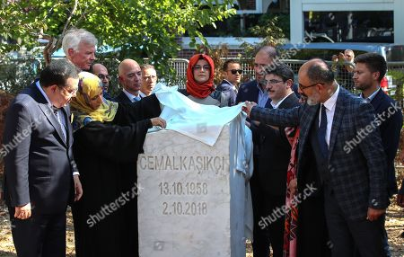 Hatice Cengiz (C), the fiancee of murdered Saudi journalist Jamal Khashoggi, CEO of Amazon and Washington Post owner Jeff Bezos (L-4), Yemeni Nobel Prize winner Tawakkol Karman (L-3) and participants stand near by memorial stone during an event marking marks one-year anniversary of the assassination of Saudi dissident journalist Jamal Khashoggi  in Istanbul, Turkey, 02 October 2019. Saudi dissident journalist Jamal Khashoggi, whose remains have not been found, was assassinated at the Saudi Arabian consulate building in Istanbul on 02 October 2018.