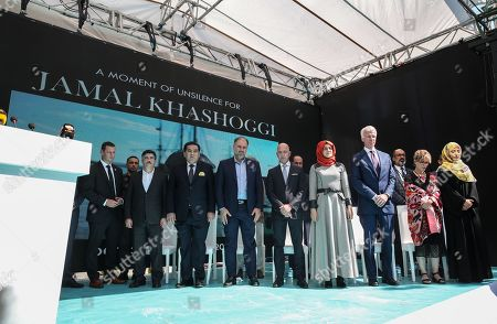 Hatice Cengiz (R-5), the fiancee of murdered Saudi journalist Jamal Khashoggi, CEO of Amazon Jeff Bezos (R-6), Yemeni Nobel Prize winner Tawakkol Karman (R) and participants stand one minute silence during an event marking marks one-year anniversary of the assassination of Saudi dissident journalist Jamal Khashoggi  in Istanbul, Turkey, 02 October 2019. Saudi dissident journalist Jamal Khashoggi, whose remains have not been found, was assassinated at the Saudi Arabian consulate building in Istanbul on 02 October 2018.