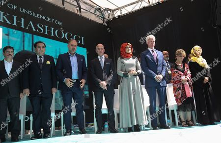 Hatice Cengiz (R-4), the fiancee of murdered Saudi journalist Jamal Khashoggi, CEO of Amazon Jeff Bezos (C), Yemeni Nobel Prize winner Tawakkol Karman (R) and participants stand one minute silence during an event marking marks one-year anniversary of the assassination of Saudi dissident journalist Jamal Khashoggi  in Istanbul, Turkey, 02 October 2019. Saudi dissident journalist Jamal Khashoggi, whose remains have not been found, was assassinated at the Saudi Arabian consulate building in Istanbul on 02 October 2018.