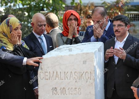 Hatice Cengiz (C), the fiancee of murdered Saudi journalist Jamal Khashoggi, CEO of Amazon and Washington Post owner Jeff Bezos (L-2), Yemeni Nobel Prize winner Tawakkol Karman (L) and participants stand near by memorial stone during an event marking marks one-year anniversary of the assassination of Saudi dissident journalist Jamal Khashoggi  in Istanbul, Turkey, 02 October 2019. Saudi dissident journalist Jamal Khashoggi, whose remains have not been found, was assassinated at the Saudi Arabian consulate building in Istanbul on 02 October 2018.