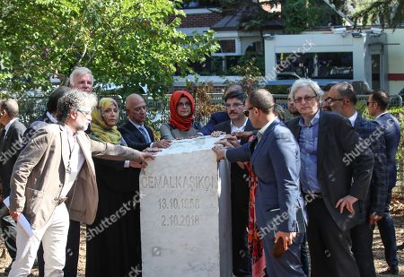 Hatice Cengiz (C), the fiancee of murdered Saudi journalist Jamal Khashoggi, CEO of Amazon Jeff Bezos (L-5), Yemeni Nobel Prize winner Tawakkol Karman (L-4) and participants stand near by memorial stone during an event marking marks one-year anniversary of the assassination of Saudi dissident journalist Jamal Khashoggi  in Istanbul, Turkey, 02 October 2019. Saudi dissident journalist Jamal Khashoggi, whose remains have not been found, was assassinated at the Saudi Arabian consulate building in Istanbul on 02 October 2018.