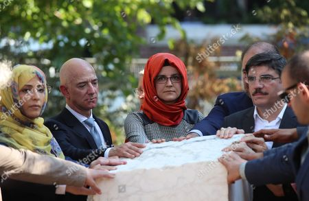 Stock Image of Hatice Cengiz (C), the fiancee of murdered Saudi journalist Jamal Khashoggi, CEO of Amazon and Washington Post owner Jeff Bezos (L-2), Yemeni Nobel Prize winner Tawakkol Karman (L) and participants stand near by memorial stone during an event marking marks one-year anniversary of the assassination of Saudi dissident journalist Jamal Khashoggi  in Istanbul, Turkey, 02 October 2019. Saudi dissident journalist Jamal Khashoggi, whose remains have not been found, was assassinated at the Saudi Arabian consulate building in Istanbul on 02 October 2018.