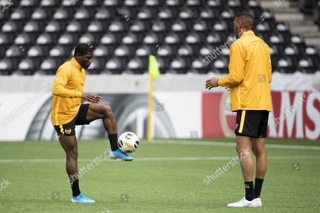 Bern's Roger Assale (L) and Guillaume Hoarau in action during a training session one day before the UEFA Europa League group stage match between Switzerland's BSC Young Boys Bern and Scotland's Glasgow Rangers, at the Stade de Suisse Stadium in Bern, Switzerland, 02 October 2019.