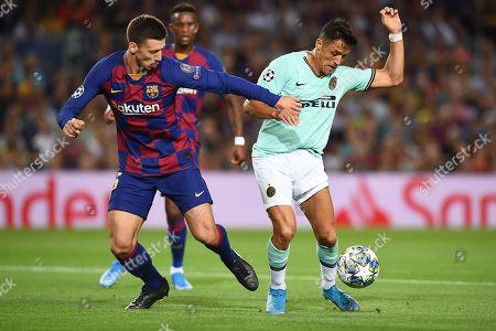Alexis Sanchez of Inter de Milan and Clement Lenglet of FC Barcelona